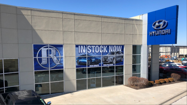 Window graphics on dealership windows promoting new cars Signs Wraps & Graphics
